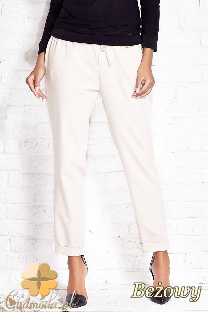 CM1408 LuĹşne spodnie damskie ze zwężonymi nogawkami - beżowe