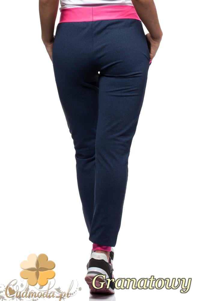 WYCOFANY Sportowe spodnie damskie z kontrastowym pasem i lamówkami - granatowe