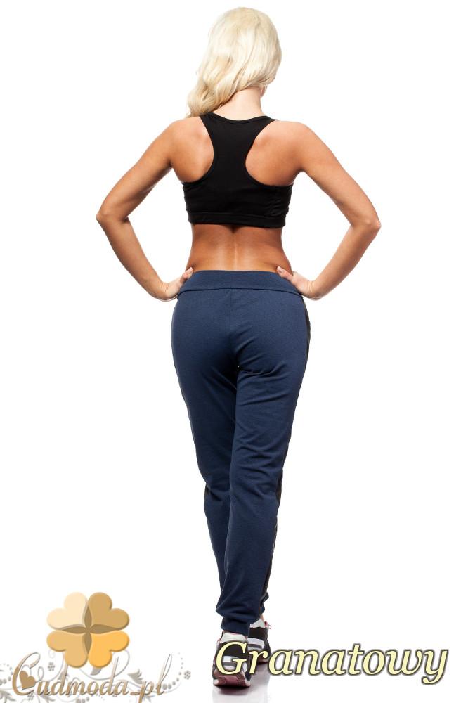 WYCOFANY Sportowe spodnie damskie z lampasem - granatowe