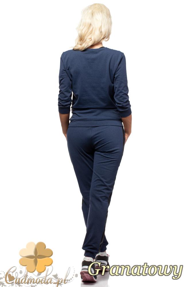 WYCOFANY Elegancka bluzka damska ze skórzanymi kieszeniami - granatowa
