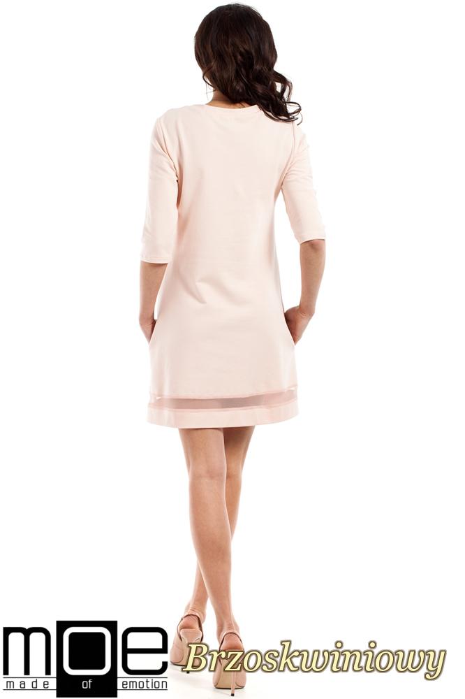 CM2221 Dzianinowa sukienka z tiulową wstawką - brzoskwinowa