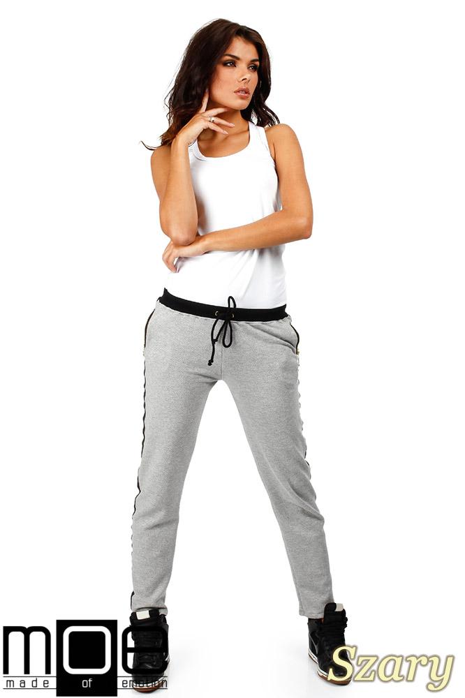 CM0359 Spodnie damskie z lampasem i zameczkami - szare
